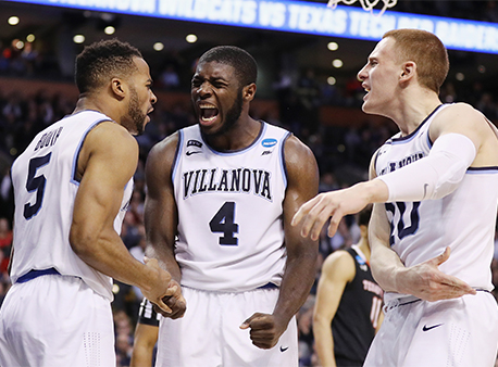 Eric Paschall, Phil Booth and Donte DiVincenzo of the Villanova Wildcats celebrate during NCAA Tournament action